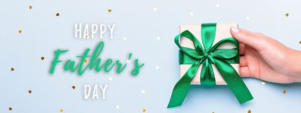 Free Woman Hand Holding Green Gift Box For Father`s Day Banner. Happy Father`s Day Holiday Greeting Card, Flat Lay With Present Box, Royalty Free Stock Image - 184318236