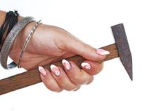 Woman hand holding hammer on isolated white cutout background. Studio photo with studio lighting easy to use for every concept.  royalty free stock image