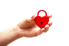 Woman hand holding heart shaped lock. Woman hand holding a heart shaped lock Stock Images