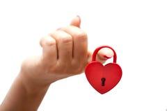 Woman hand holding heart shaped lock. Woman hand holding a heart shaped lock Royalty Free Stock Image