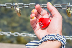 Woman hand holding heart shaped padlock Stock Images