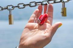 Woman hand holding heart shaped padlock Royalty Free Stock Photography