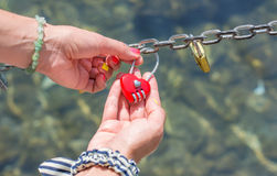 Woman hand holding heart shaped padlock Royalty Free Stock Images