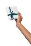 Woman Hand holding Holiday Present White Box with Blue Ribbon Stock Photography