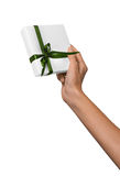 Woman Hand holding Holiday Present White Box with Green Ribbon Royalty Free Stock Photos
