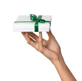 Woman Hand holding Holiday Present White Box with Green Ribbon Stock Photos