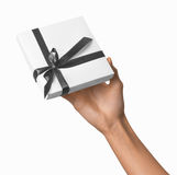 Woman Hand holding Holiday Present White Box with Grey Ribbon Royalty Free Stock Photo