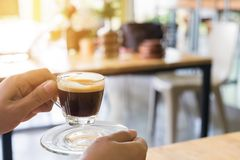 Woman hand holding hot espresso shot Stock Photography