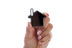 Woman hand holding house Stock Image