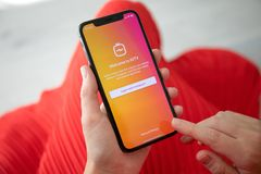 Woman hand holding iPhone X social networking service IGTV Insta royalty free stock photos