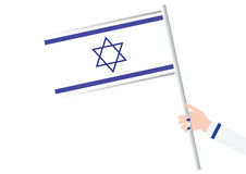 Woman Hand holding an Israeli flag Royalty Free Stock Photography