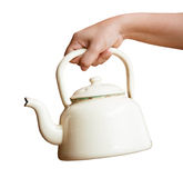 Woman hand holding kettle Stock Images
