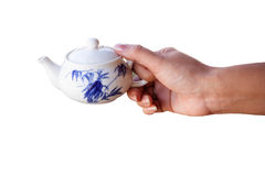 Woman hand holding kettle Royalty Free Stock Photography