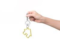 Woman hand holding key with house shape keyring Royalty Free Stock Photo