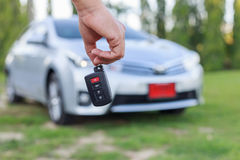 Woman hand holding key of new car Stock Images