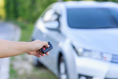 Woman hand holding key of new car Royalty Free Stock Images