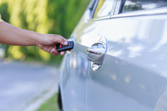 Woman hand holding key of new car Royalty Free Stock Image