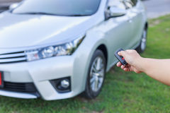 Woman hand holding key of new car Royalty Free Stock Photography