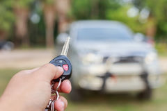Woman hand holding key of new car Stock Photo