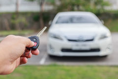 Woman hand holding key of new car Stock Photography