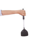 Woman hand holding a kitchen spatula Stock Photos