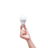 Woman hand holding LED bulb isolated on white background Stock Photos