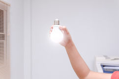 Woman hand holding LED bulb Stock Images