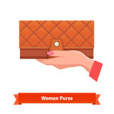 Woman hand holding luxury leather purse Royalty Free Stock Photography