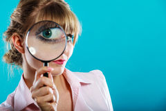 Woman hand holding magnifying glass on eye Stock Photos