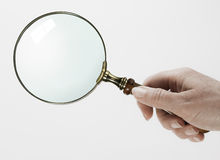 Woman hand holding magnifying glass Royalty Free Stock Image