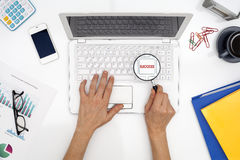 Woman hand is holding magnifying on keyboard button Royalty Free Stock Photography