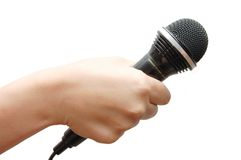 Woman hand holding a microphone Royalty Free Stock Photos