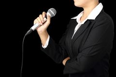 Woman hand holding microphone with clipping path royalty free stock photography