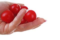 Woman hand holding mini tomatoes on isolated white cutout background. Studio photo with studio lighting easy to use for every conc. Ept stock images