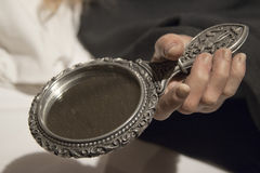 Woman hand holding a mirror Royalty Free Stock Photos