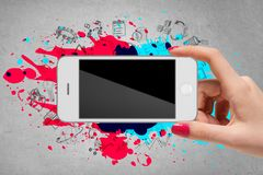 Woman hand holding mobile phone on grey background Royalty Free Stock Photos