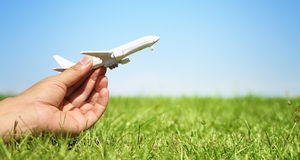 Woman hand holding a model plane Stock Photo