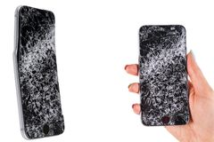 Woman hand holding modern mobile smartphone broken screen and damages. Cellphone crashed and scratch. Device destroyed. Smash gadg. Et, need repair. Isolated on royalty free stock images