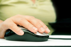 Woman hand holding mouse Royalty Free Stock Image