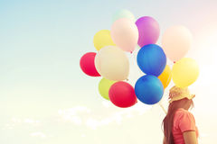 Woman hand holding multicolor balloons Stock Image