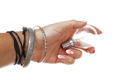 Woman hand holding old glass light bulb on isolated white cutout background. Studio photo with studio lighting easy to. Use for every concept.White background royalty free stock photo