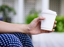 Woman Hand holding Paper Cup coffee Outdoor Stock Photos