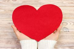 Woman hand holding paper red heart shape. copy space Royalty Free Stock Image