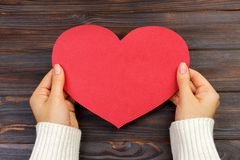 Woman hand holding paper red heart shape. copy space Stock Image