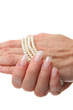 Woman hand holding pearl jewelery Royalty Free Stock Photo