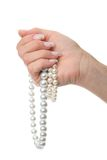 Woman hand holding pearl jewelery Royalty Free Stock Photos