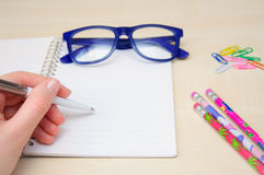 Woman hand holding pencil and writing notebook Royalty Free Stock Photography