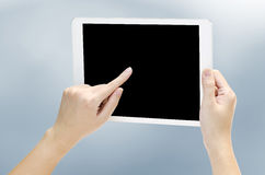 Woman hand holding the phone tablet Royalty Free Stock Image