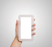 Woman hand holding the phone tablet touch computer Royalty Free Stock Images