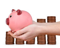 Woman hand holding a pink piggy bank Stock Photo